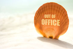 Out of office inscription on shell Stock Photo