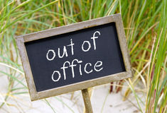 Out of Office Sign on Beach Stock Photos