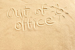 Out Of Office Sign On Beach Sand Scribbled
