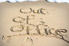 Out of office text written in sand on a beach Stock Photos