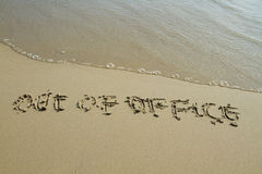 Out of office word on the beach Stock Photo