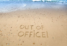 Out of office. Written in the sand at the beach Stock Photo