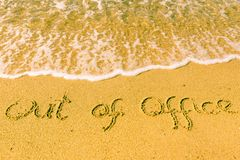 Out of office written on sand. Sandy beach with Out of office sign scribbled on beach sand. leisure time concept royalty free stock photography