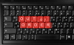 Out of order. Computer laptop keyboard showing out of order text colored in red Stock Image