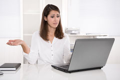 Out of order: businesswoman frustrated with problem on laptop Stock Photos