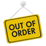 Out of Order Sign. A yellow and black sign with the words Out of Order isolated on a white background stock photography