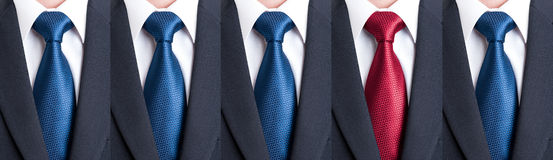 Out of the pattern or crowd with different color tie Stock Photography