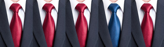 Out of the pattern or crowd with tie or necktie Royalty Free Stock Photos