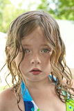 Out from the Pool. Portrait of young girl with wet hair and bathing suit Royalty Free Stock Photo