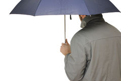 Out in the Rain. Man with an umbrella and raincoat isolated on white Stock Photos