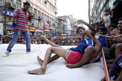 Out of ring. Red Wrestler taking out blue wrestler in a wrestling match organised in the occasion of Diwali at Raja Katra, Kolkata stock photos