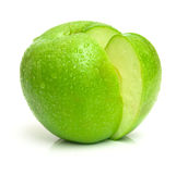 With out segment 2. Ripe apple of green color with the segment cut out from it. Isolation. Shallow DOF royalty free stock photography