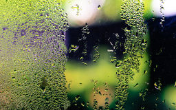 Out side weather ! Water drops. A photo of a glass of window shows some drops of waters because of the humid weather outside the cold room Royalty Free Stock Photography