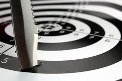Out of the target. A machete that misses the center of the bullseye stock photo