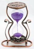 Out of time. Sand-glass, hourglass sand with purple on a white background Stock Image