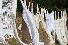 Out to dry. Crochet vests out to dry Stock Images