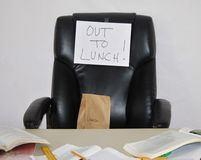 Out to lunch. Forgotten lunch on office chair Stock Photography