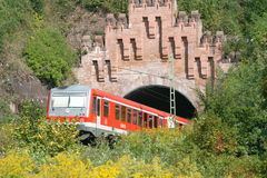 Out of the tunnel. Hochspeyer 08th September: German regional train at tunnel exit stock photo