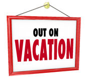 Out on Vacation Hanging Sign Store Office Closed. Out on Vacation words on hanging sign for store window or office wall to tell customers or co-workers that you Stock Photos