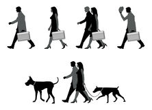 Out walking. Collection of busy people silhouettes walking Royalty Free Stock Images