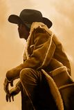 Out West. A cowboy takes time to rest and reflect Royalty Free Stock Photo