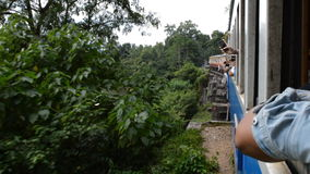 Out of window. Train in Thailand stock video footage