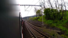 Out-of-window view of train going passing beautiful nature. 