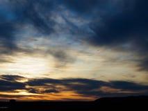 Outaouais Sunset. A lone bird flies across the sky as the sun sets over Ottawa and Gatineau, Canada Stock Photos