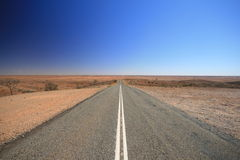 Open Outback Australia Road. Vanishing into the Desert stock image