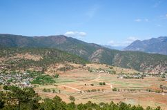 Outback countryside in China. Foreground have yellow field and background had mountain,small hut Royalty Free Stock Images