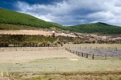 Outback countryside in China. Foreground have yellow field and background had mountain,small hut Royalty Free Stock Image