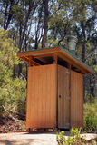 Outback dunny; tall view. A fair dinkum outback dunny in an Australian forest reserve. A dunny is a toilet, for those who don't know Royalty Free Stock Photography