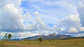 Outback Landscape. Clouds over a range of rugged Australian hills Stock Image
