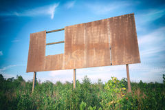Outback old sign. Outback rusted blank damaged and old sign in the long grass Stock Photo
