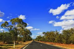 Outback Road from Car Forward. Remote empty B55 highway in remote rural outback of NSW state in Australia on a hot sunny day under blue sky driving between royalty free stock photo