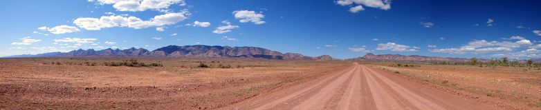 Outback Road & Mountain Range Stock Images