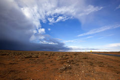 Outback Storm. Storm brewing over the red earth of the Australian outback.  Western New South Wales, near Broken Hill Royalty Free Stock Photos