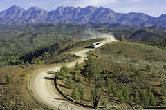 Outback Trek. Tourist bust travels along a dusty outback road in South Australia's rugged Flinders Ranges Stock Photos