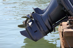 Outboard boat motors and propellers. And reflections on water surface Royalty Free Stock Photo