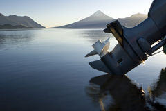 Outboard engine. With a lake and mountains background Royalty Free Stock Images