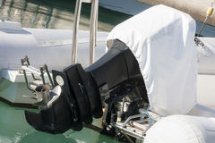 Outboard engine with cover Stock Images