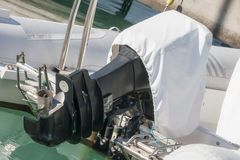 Outboard engine with cover Royalty Free Stock Photo