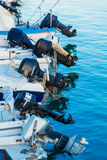 Outboard engines on fishing boats Royalty Free Stock Image