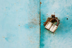 Outboard lock or padlock on vintage turquoise background, protection system concept Stock Photos