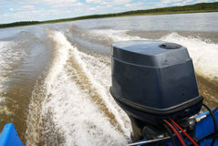 Outboard motor boat on the river Stock Images