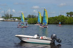 Free Outboard Motor Boat Sailing Catamarans And Paddle Boarders Royalty Free Stock Images - 74600649