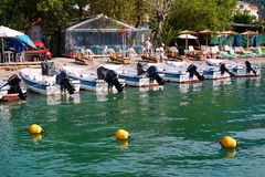 Outboard Motor Boats for Hire, Lefkada, Greece. A number of small outboard motor boats, runabouts, for rent at Nidri harbour, Lefkada, an Ionian Greek island Royalty Free Stock Photo