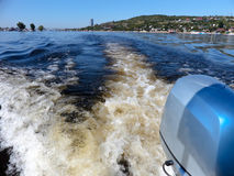 Outboard motor. Summer river landscape, photographed from the side of the boat. Russia, Saratov, the Volga river. Road bridge Stock Images