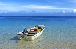 Outboard motorboat on tropical waters stock photos