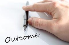 Outcome concept. Pen in the hand  over white background Outcome concept Stock Photos